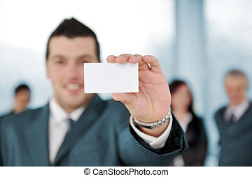 Businessman holding blank sign at business meeting