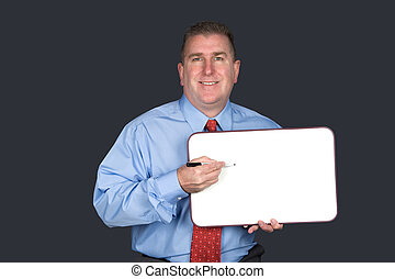 Businessman holding blank whiteboard