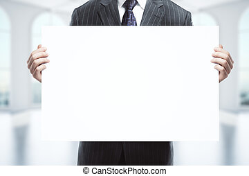 Businessman holding blank whiteboard