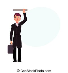 Businessman holding briefcase in subway, standing and holding handrail
