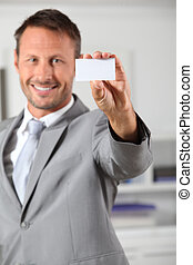 Businessman holding business card