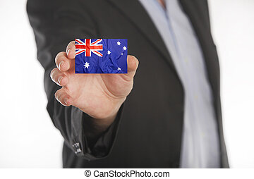 Businessman holding business card with Australian flag