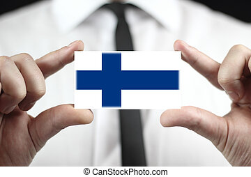 Businessman holding business card with Finland Flag