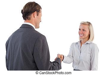 Businessman holding business woman hand