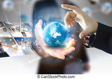 businessman holding business world
