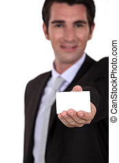 Businessman holding calling card
