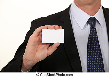 Businessman holding card