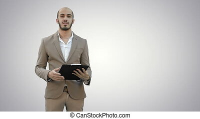 Businessman holding clipboard and presenting business report on white background.