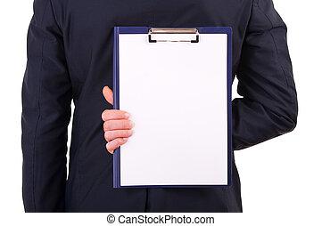 Businessman holding clipboard behind back