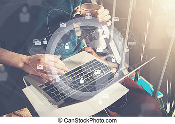 Businessman holding cup of coffee in hand and working with laptop. Generic design laptop on his knees. Digital interface effect. Horizontal mockup