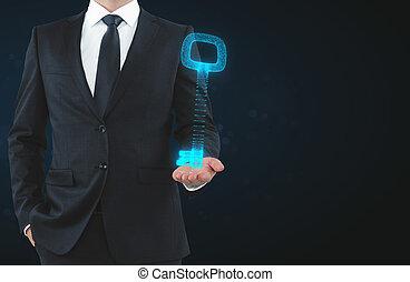 Businessman holding digital key