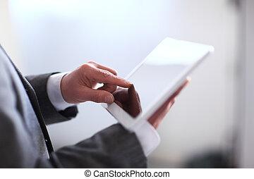 Businessman holding digital tablet
