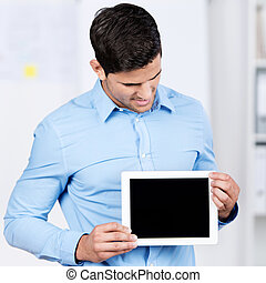 Businessman Holding Digital Tablet While Looking At It