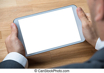 Person holding digital tablet on blueprint close up of a stock businessman holding digital tablet with blank screen malvernweather