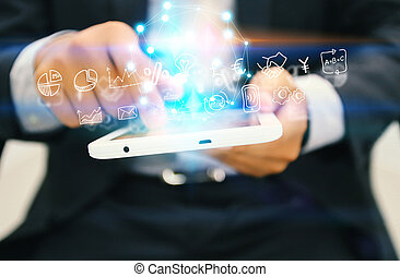 Businessman holding digital tablet with icons globalization business.