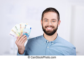 Businessman Holding Euro Notes In Office