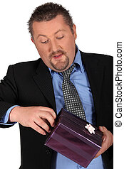 Businessman holding gift