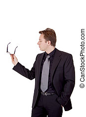 Businessman holding glasses