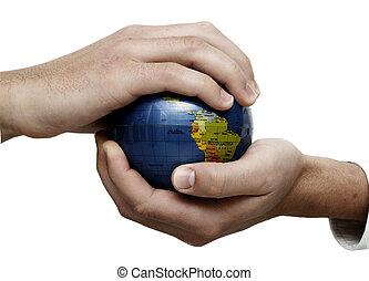 Businessman holding globe - Businessman holding and examing ...