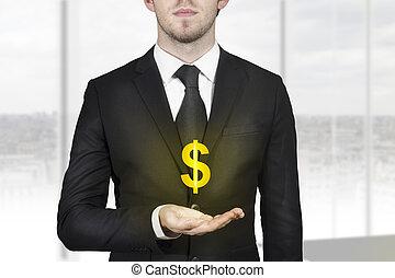 businessman holding golden dollar symbol - businessman in...