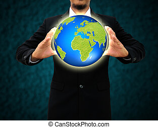 businessman holding green Earth in hands .Environmental concept
