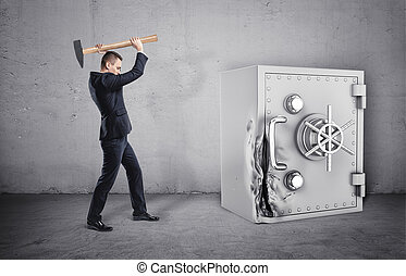 Businessman holding hammer over his head, and safe with its door broken