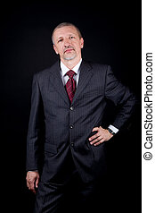 Businessman holding hand on waist