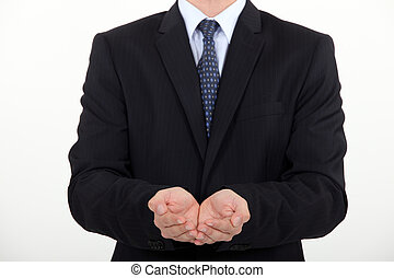 Businessman holding hands out