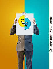 Businessman Holding Happy and Sad Faces