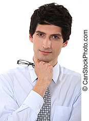 Businessman holding his eyeglasses