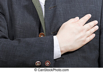 businessman holding his hand on his chest