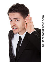 Businessman holding his hand to his ear