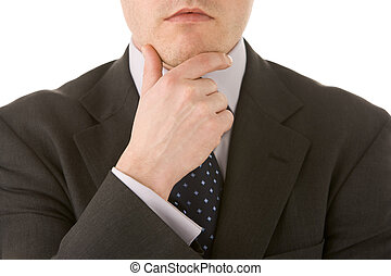 Businessman Holding His Hand Up To His Chin