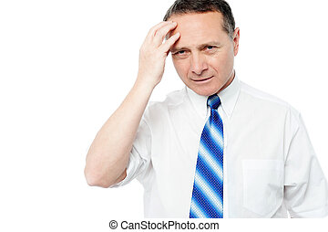 Businessman holding his head