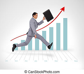 Businessman holding his suitcase running against a graph