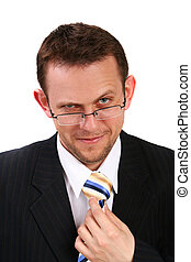 businessman holding his tie and loo