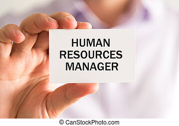 Businessman holding HUMAN RESOURCES MANAGER card