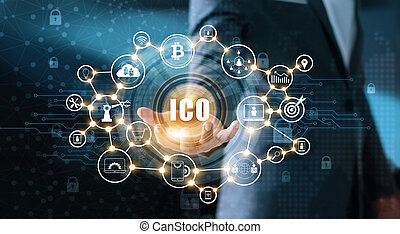 Businessman holding icon with ICO on a interface virtual screen. Digital currency network concept