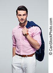 Businessman holding jacket on shoulders