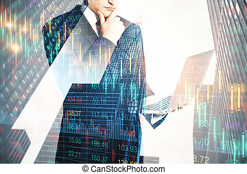 Businessman holding laptop computer and falling chart hologram
