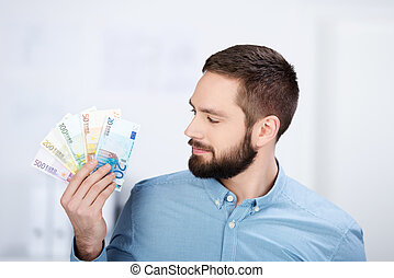 Businessman Holding Looking On Euro Notes