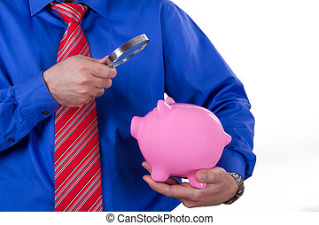 Businessman Holding Magnifying Glass and Piggy Bank