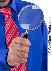 Businessman Holding Magnifying Glass