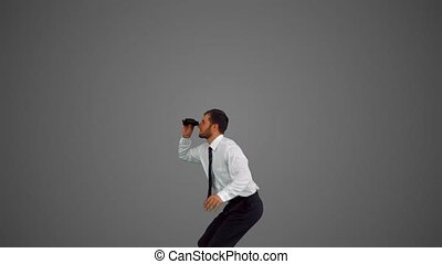 Businessman holding megaphone and jumping up on grey...