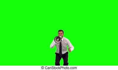 Businessman holding megaphone jumping up and shouting on...