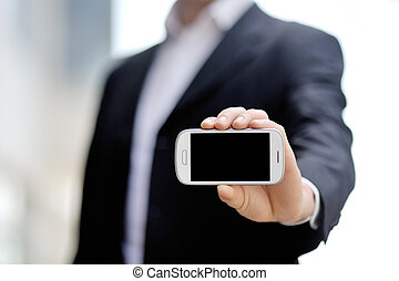 businessman holding mobile smart phone in hand