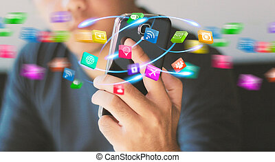 Businessman holding mobile smartphone with social icons.