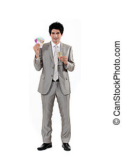 businessman holding money in cash and a glass of champagne