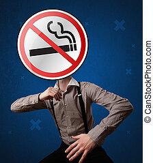 Businessman holding no smoking sign