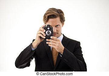 Businessman holding old camera